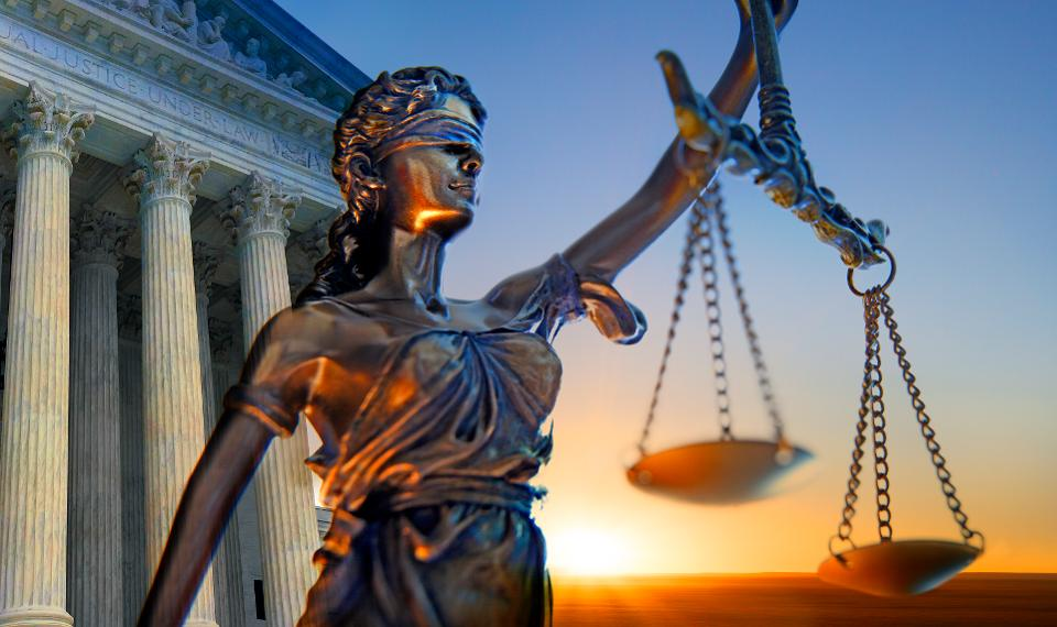 Blind Justice holding scales